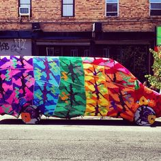 van yarn bomb - wow this must have taken some time to knit! Is that supposed to be a camouflage pattern?