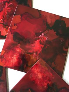 This set of 4 coasters is titled A Single Light Crackled and has varying shades of red, burgundy and a hint of yellow and a crackled finish.