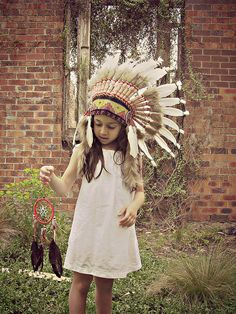 Little girl, indian headdress, feather hat, cowboys, indians, photoshoot, dream catcher