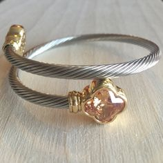 Cable Twist Two Tone Bangle (3 colors available) Silver very adjustable bangle with a peach green or Pearl Stone. Price firm. Please let me know which color you would like and I'll make you a listing  no trades and no holds. Jewelry Bracelets