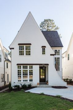 Updated White Brick Tudor via White Exterior Houses, Small House Exteriors, Dream House Exterior, White Houses, Tudor Style Homes, Cute House, Cute Little Houses, Tudor House, H & M Home