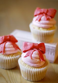 bows on top of cupcakes makes them even sweeter!