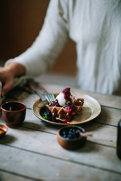 Chocolate waffles with ice creams and raspberry sauce / Marta Greber