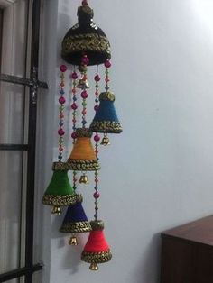 Wind chimes here is the procedure for wind home 5 bottles of small coca-cola bottles & 1 big bottle & put holes on the top portion of the ca Plastic Bottle Tops, Plastic Bottle Crafts, Recycle Plastic Bottles, Diy Home Crafts, Handmade Crafts, Easy Crafts, Diwali Diy, Diwali Craft, Hobbies And Crafts