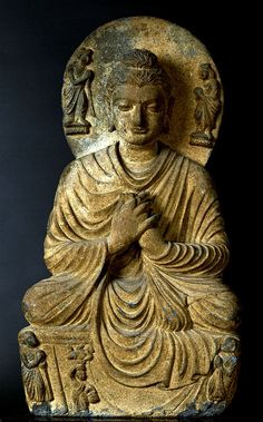 ancientpeoples:    Buddha schist  From Gandhara, Pakistan  Kushan Dynasty, 2nd - 3rd century AD  Source: Tokyo National Museum