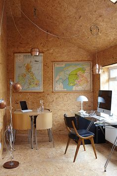 Upstairs, Flach's study – he is a professor of artificial intelligence – is another retro space, clad entirely in raw strawboard. The effect is both cosy and workmanlike. 'The builders kept saying, 'When are you going to paint it?'' Richardson says. The copper lamps were vintage finds – for similar, try Tom Dixon's copper shades.