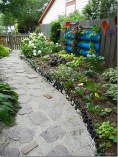 Wine bottle path and shovel wall garden
