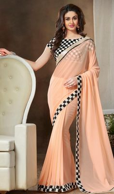 Be a charmer wearing this papaya whip color georgette lace work sari. The amazing attire creates a dramatic canvas with incredible lace and resham work. Upon request we can make round front/back neck and short 6 inches sleeves regular saree blouse also. #LatestNewPrintedBorderSari