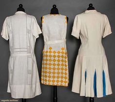 "THREE WHITE LINEN DAY DRESSES, 1920s Go Back Lot: 77 April 8, 2015 NYC New York City Possibly for sports wear: 1 sleeveless, goldenrod yellow triangle appliques, diamond print on skirt, B 34"", H 39"", L 37""; 2 w/ short sleeves: 1 w/ 3 embroidered patch pockets & alternating blue linen skirt gores, B 36"", H 41"", L 41"", (hem unpicked) & 1 w/ drawn thread work, B 34""-36"", L 40"", (all 3 w/ minor stains) very good; t/w 1 eyelet linen day dress. Suddon-Cleaver Collection, Toronto."