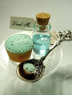 Maybe this for a childs party!! A lemon cake, a tiny bottle of tequilla and a sprinkle of salt on a spoon - Alice in Wonderland!