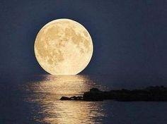 Super moon over the ocean.