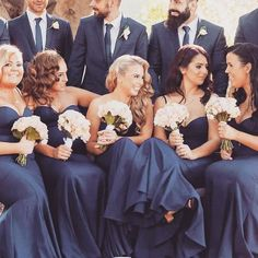 A gorgeous bridal party in our Arianna navy gown @inlightenphotography…