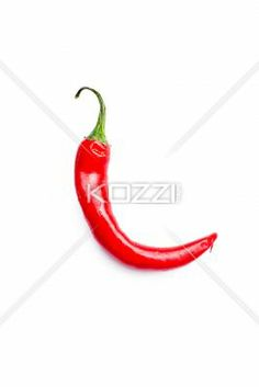 Curved Chilli Pepper - A curved red hot chilli pepper on a white background