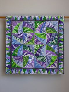 "This 40"" sq. quilt is inspired by a pattern by Karen Stone."