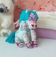 Hand knitted little pony toy with wings  by EfisWhimsicalCrafts