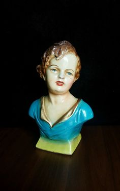 """Antique Art Nouveau Chalkware Bust. Measures 7 3/4"""" tall. She has a chip at nose, marks on cheek and a few flakes. Otherwise she is in good condition with a shiny glaze.  Thanks! 