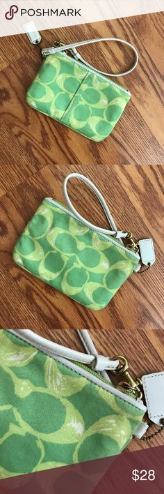 """Coach Signature C Scribble Wristlet in Green Authentic Coach Signature C Scribble Wristlet in Green. Adorable green Coach wristlet with white accents & goldtone hardware. Measurements: 6"""" x 4"""". Wristlet was used & has small spot (pictured). Reasonable offers considered. No trades ❣️❣️ Coach Bags Clutches & Wristlets"""