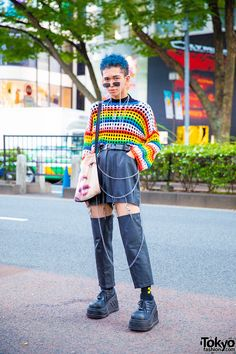 Blue-haired Harajuku student sporting a knit over black shirt, faux leather cutout pants, black lace-up shoes and a face print bag. Tokyo Street Fashion, Tokyo Street Style, Japanese Street Fashion, Japan Fashion, Look Fashion, Fashion Outfits, Fashion Black, Petite Fashion, Looks Style