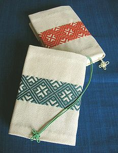 Kogin Embroidery. I've done Sashiko before, but this looks interesting too.