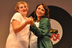 """Marty (played by Martianna Scott) sings """"Freddy My Love"""" with the Pink Ladies at her Pajama Party in the Highland High School Harlequin's production of Grease."""