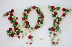 """Jingle Bell """"JOY"""" Letters decoration.  would be cute in yarn too"""