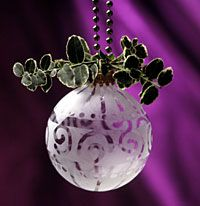 A touch of winter white is easy to mimic when you etch simple glass ornaments. Use our ideas to develop your own seasonal designs.
