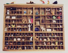 Letterpress turned into a shelf for figurines and knickknacks.
