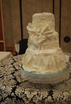 wedding cake, white bow, flowers, drapes, Cake Guru, Oshkosh, Wisconsin