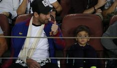 Barcelona forward Lionel Messi sits in the stands prior to . Lionel Messi, Champions League, Captain Hat, Barcelona, Baseball Cards, Barcelona Spain