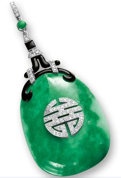 JADEITE, DIAMOND, ENAMEL AND ONYX PENDANT, CIRCA 1925, BOUCHERON    Of Art Deco design, the translucent jadeite plaque of emerald green colour suffused with white patches; decorated with a Chinese calligraphy shou (壽) set with brilliant-cut diamonds, symbolising longevity, surmounted by brilliant-cut diamonds, black enamel and onyx-set links, mounted in platinum, signed.