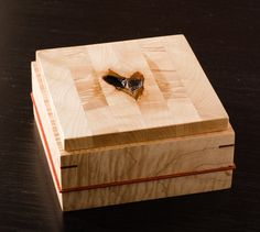 A handmade wooden box with natural heart shaped by LaFondWoodworks
