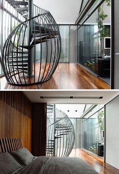 This sculptural and modern black metal spiral staircase looks more like a birdcage with the black metal rods curving around the spiraling steps.
