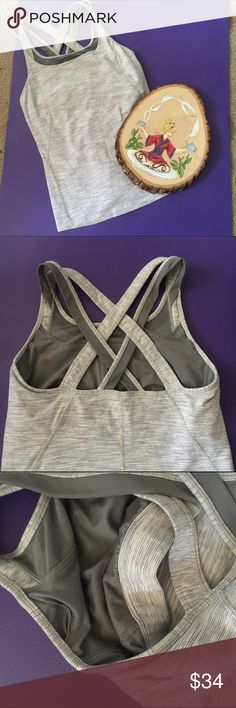 LuluLemon Cross Back Tank LuluLemon Tank with double straps and cross back with belt in shelf bra. No padding but there are slots for inserts. In excellent condition. lululemon athletica Tops Tank Tops
