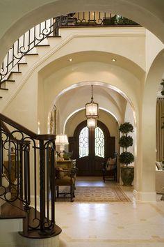 Gorgeous foyer with beautiful archways | Charisma Design    ᘡղbᘠ