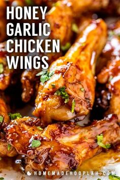 Honey Garlic Chicken Wings! These honey garlic chicken wings are baked in the oven until nice and crispy and then coated in a sticky honey garlic sauce. Easy to adjust the recipe to make the wings mild in flavor or add a little extra kick! | HomemadeHooplah.com