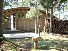 Modern and curvy sauna building with a light interior