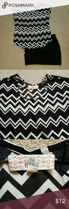 Black and white blouse Black and white chevron style blouse. Chiffon material, only worn once for an interview. Sleeves are folded. Pink Republic Tops Tees - Short Sleeve