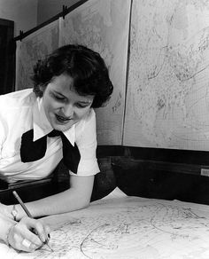 WAVES Aerographer's Mate working with weather charts, Naval Air Station, Lakehurst, New Jersey, United States, November 1943.
