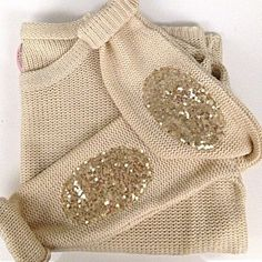 Sequins elbow patches. I love sweaters with elbow patches.