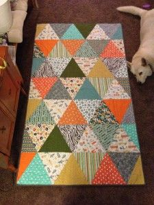 Great beginner tutorial on a triangle scrappy looking quilt. Step by step instructions for the first time quilt maker. Bonus instructions for mitered corners. DLW