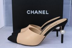 Get the must-have mules of this season! These Chanel Beige Runway Black Leather Heels Pearl 37 Mules/Slides Size US 7 Regular (M, B) are a top 10 member favorite on Tradesy. Save on yours before they're sold out! Chanel Mules, Chanel Sandals, Chanel Runway, Black Leather Heels, Sexy High Heels, Designer Shoes, Me Too Shoes, Heeled Mules, Fashion Shoes