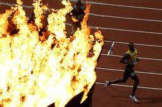 Usain Bolt celebrates winning the 100m.