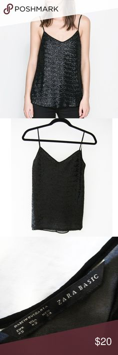 "Zara Black Sequin V-Neck Sheer Back Cami XS Black sequin v-neck camisole top featuring a sheer back. Pair it with trousers and a jacket for a played down look or dress it up with a skirt and accessories for a party look. Excellent condition-only worn once. Smoke/pet-free home. Feel free to ask questions! All images are my own except for the first photo. Credited to Zara online image. Measurements: Front Length (shoulder to hem): 23 1/2"" approx. Center Front Length: 16""  Bust: 33"" approx…"