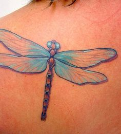Dragonfly Tattoo. I love this one. It's pretty simple and the blue is so pretty.
