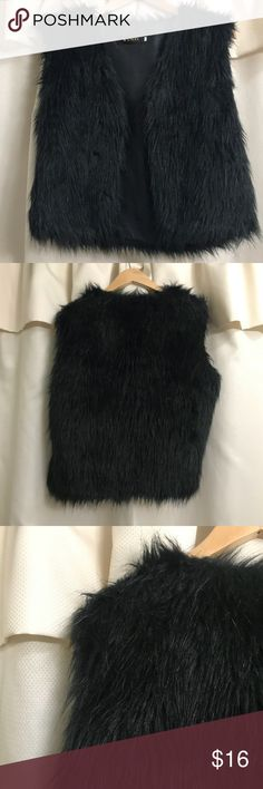 "Black Faux Fur Vest Size Medium - Large Black Fur Vest by Wenxi. Although is is marked as ""XXL"" (again sizing) id say it runs small. It converts to a size L in US Sizing and can also possibly fit a medium. Never worn, in great condition. NWOT wenxi Jackets & Coats Vests"
