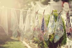 A banner of vintage hankies...oh so lovely!  love this....I will do this when I'm able.