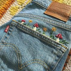 Sew some mushrooms on your jeans for embroidery fun! Embroidery On Clothes, Simple Embroidery, Embroidered Clothes, Embroidery Art, Embroidery Patterns, Embroidery On Denim, Vintage Embroidery, Flower Embroidery, Diy Embroidered Jeans