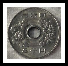 Japan 50 yen 1983 Condition VF. The flower on this coin is the chrysanthemum or kiku in Japanese. The Japanese royalty lover this flower because they believed it had the power to prolong people's lives. For this and more Japanese coins, please visit AlbaCoins. com #japan #coins #coincollecting