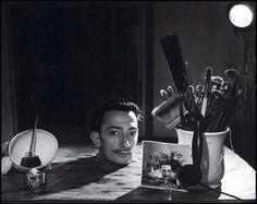 Salvador Dali head with still life
