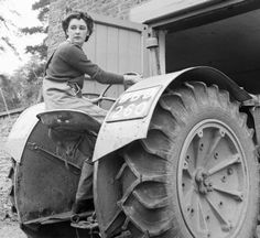 Anne Keys of the Women's Land Army reverses a tractor out of a shed during her training at the Northampton Institute of Agriculture near Moulton in Antique Tractors, Vintage Tractors, Old Tractors, Vintage Farm, War Photography, People Photography, Old Photos, Vintage Photos, Women's Land Army